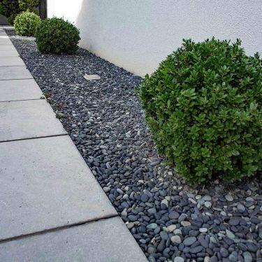 Beach pebbles aangelegde tuin